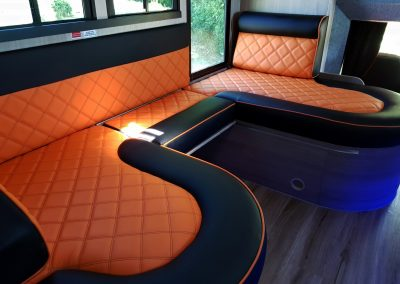 Helios 7.5 tonne horsebox living with orange upholstery